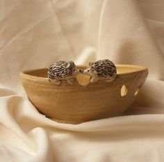 Yarn bowl, Ceramic yarn bowl with engraved and sculpted Hedgehogs, knitting yarn bowl. $45.00, via Etsy.