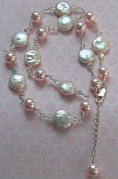 Pretty - pearls make a great gift anytime - Mom will love them.  Pearl Necklace by RuffinoGlassStudio on Etsy, $30.00
