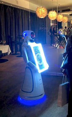 Interactive robot photographer equipped with sensors to achieve precise indoor navigation and obstacle avoidance. With a touch-screen that enables social media sharing and text messaging. Robot Art, Robots, Text Messaging, Fiction, Indoor, Entertainment, Social Media, Touch, Drawing