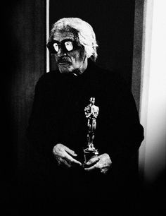 """Luis Buñuel (above, in disguise, with the Oscar.) - When [The Discreet Charm of the Bourgeoisie] had been nominated for an Oscar, four Mexican reporters tracked us down at El Paular, where we were already at work on another project. During lunch, they asked if I thought I was going to win that Oscar.  """"Of course,"""" I replied between bites. """"I've already paid the twenty-five thousand dollars they wanted. Americans may have their weaknesses, but they do keep their promises.""""  A few days…"""