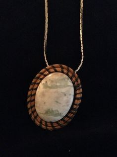 Pine+Needle+Pendant+Necklace+on+Silvertone+Chain+by+PineDesigns,+$28.00