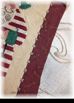 the small cross stitches connecting the binding with the body of the work --- beautiful!