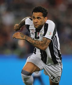 Dani Alves of Juventus FC celebrates after scoring the opening goal during the TIM Cup Final match between SS Lazio and Juventus FC at Olimpico Stadium on May 17, 2017 in Rome, Italy.