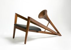 The Trumpet Chair is a contemporary interpretation of the famous musical instrument. The oblong form, created in solid Burma teak wood is intriguing and congenial. A piece crafted to literally create music in design. #RBY #trumpetchair #trumpet #musical #contemporaryfurniture