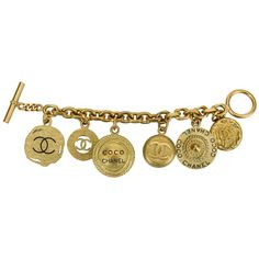 Chanel Oversize Satin Gold Coin Charm Bracelet | From a unique collection of vintage charm bracelets at https://www.1stdibs.com/jewelry/bracelets/charm-bracelets/