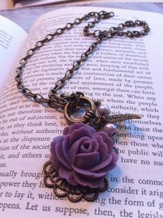 Love the purple rose and antique metal look.