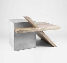 Hochwertig und teuer, aber schön: Couchtisch mit einem Element aus Beton und Holz. Hier entdecken und shoppen: http://sturbock.me/JNI
