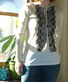 Pretty lace cardigan from an old sweater tutorial.