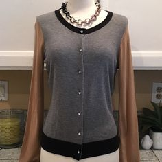NWT Express Sweater Beautiful color block sweater with small crystal stone buttons. Just gorges to dress up or wear casual. In excellent New condition. Express Sweaters Cardigans