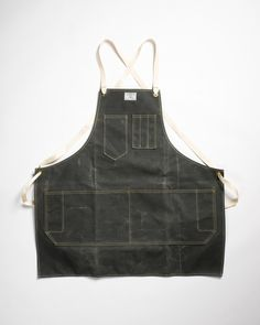 """Artifact Bag Co. has made durable handmade products in Omaha, NE since 2010. With little more than canvas, leather and thread, this small operation produces """"greater than its parts"""" design you can put on your body and abuse. The Artisan Apron is a great example. It combines simple tough materials with simple useful style, and the outcome is fantastic: rugged, attractive workwear you can use daily and be proud of while you do. Whether you're drawn to traditional tough waxed canvas, or light…"""