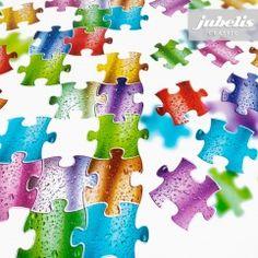 jubelis® - coole Tischdecke aus Wachstuch mit vielen bunten Puzzle Teilen