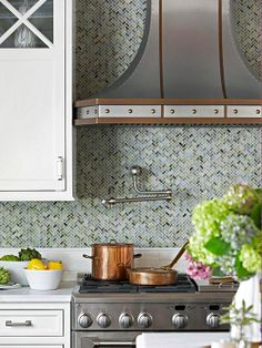 gorgeous herringbone glass tile backsplash