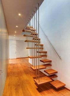 Modern wooden stairs design give a new look to a traditional material and transform a staircase into a piece of art. Wooden stairs are the most popular Small Staircase, Floating Staircase, Staircase Design, Stair Design, Staircase Ideas, Wood Stairs, House Stairs, Attic Stairs, Basement Stairs