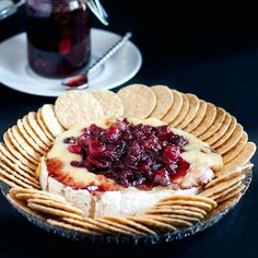 Baked Brie with Fresh Cranberries Recipe Appetizers with cranberries, water, granulated sugar, balsamic vinegar, brie cheese, olive oil, bread, crackers