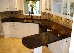 Black concrete countertops...don't want black, but I love the finish on these