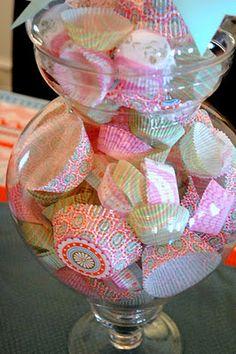 fill jar with cupcake liners, neat cupcake bake sale centerpiece.