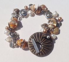 ABS JULY - Art Bead - Polymer Clay Toggle by Terri G. with Misc. Metal and shell beads and Charms and Natural shells and glass pearls. Bracelet Crafts, Bracelets, Monthly Challenge, First Art, Beach Jewelry, Bead Art, Blue Bird, Gemstone Beads, Bracelet Watch
