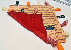 """I had heard of """"Taggies"""" blankets before and how much babies enjoy them. I was so inspired that I created a DIY so you can make a """"taggies"""" blanket too."""