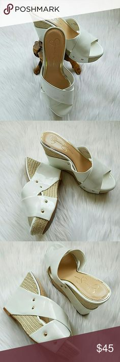 """💥FINAL SALE💥 JESSICA SIMPSON NORTH WEDGE Playful to city chic looks! Patent upper in a wedge slide sandal style with an open toe Crisscross strap design Smooth lining with a cushioning footbed 1 1/2 """" jute-wrapped platform midsole with a stud accents Traction outsole  4 1/2""""  Height heel Color: Soft White Patent PRICE IS FIRM-FINAL SALE ! Jessica Simpson Shoes Wedges"""