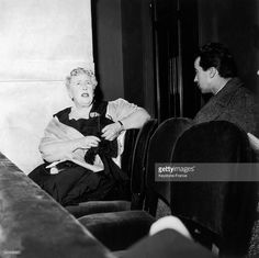 The British writer Agatha Christie in Paris. She is attending the representation of her theatre play, 'Witness for the Prosecution', adapted by Henri Torres, she is sitting in the dock (which is an important element of the set) and congratulating two actors : Odile Mallet and Gabrielle Fontan on November 4, 1955 in Paris, France