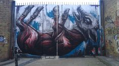 A painting of a skinned pig by street artist ROA in Buxton Street near Brick Lane.