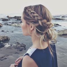 Braided crown with a loose bun for a beach day