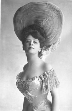 """Camilla Antoinette Clifford (1885 – 1971) was a Belgian-born stage actress and the most famous model for the """"Gibson Girl"""" illustrations. Her towering coiffure and hourglass figure defined the Gibson Girl style."""