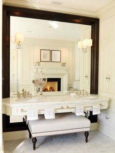 Bathroom with a floating marble vanity designed by Julie Charbonneau, via @sarahsarna.