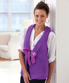 """Free pattern -""""Stunning Vest""""!  RH Shimmer: 2 (3, 3, 4, 4, 4) balls Purple.  Crochet Hooks: I/9/5.5mm  + K/10.5/6.5mm.2 yards satin ribbon, 1"""" wide, Directions are for Adult size Small; changes for sizes Medium, Large, X-Large, 2X + 3X are in ( ).  free pdf from Red Heart (add pockets, and a different closure, and it would be perfect)"""