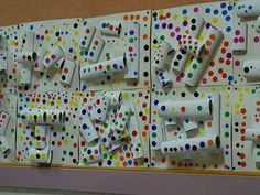 "K- project- Obliteration Room: create ""white relief background"" w/cardboard tubes, etc. Add dot stickers"