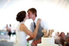 I love how the kiss is out of focus, and I love the quirk of the squirrel wedding cake topper.  This is perfect.