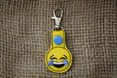 A personal favorite from my Etsy shop https://www.etsy.com/listing/494429301/emoji-laughing-crying-key-fobsnap