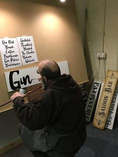 Signwriting Gin Palace sign, a behind the scenes look at signwriter Andrew Butler at work. #signwriting #signwriter #ginpalacesign #behindthescenes