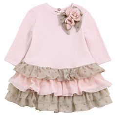 Dress top and sleeves made of light pink milano jersey. Round neck with a pearly button at the back. Neckline trimmed with flowers. Flounced hem. - 122,50 €