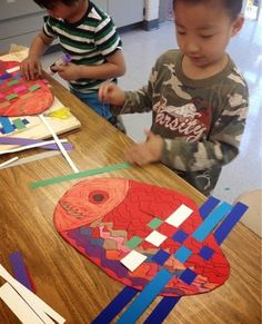 Mrs. Knight's Smartest Artists: Kindergarten lately... Kindergarten fish weavings - so cute!