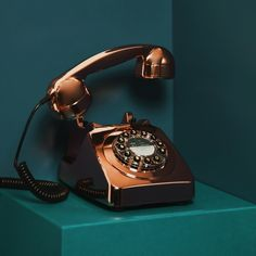 We're bringing the land line back with this iconic British telephone circa 1967. We kept the authentic vintage silhouette, but added a few 2016 upgrades. The dial has been replaced with push buttons. A redial button is a new add as well. Not to mention the gorgeous metallic copper finish. Push button phone lugs into the standard land line socket. Makes a fun housewarming gift.