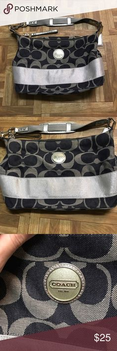 COACH purse A friend gave this to me. This is a coach purse in basically brand new condition. Inside features 3 pockets one a zip pocket, and inside is in excellent condition. This bag is a very dark navy almost black color with the gray coach logos. Features a sparkly stripe all around the bottom of bag. Bottom of bag has no stains. Silver chrome details like strap and handle. Unsure of original price. Coach Bags Shoulder Bags
