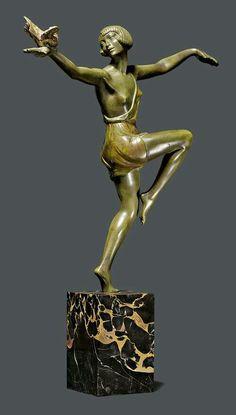 """PIERRE LE FAGUAYS (1892-1962) SCULPTURE """"L'oiseau bleu"""", ca. 1925. Bronze, green- and brown-patinated. Female dancer with a bird, on a black marble base. Signed Le Faguays, """"L'oiseau bleu"""". H 54 cm."""
