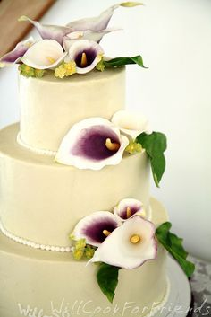 Calla Lily Wedding Cake, with vanilla swiss meringue buttercream and blackberry filling - tastes as good as it looks!
