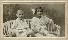 ~ 1910. Two siblings with playthings. Found photo, Hungary Cabinet card
