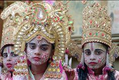 Hindu kids with bright make-up looking at camera