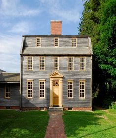 When it was built in 1755, Tate House in Portland, Maine was considered a large and elegant home. The house was constructed for Captain George Tate (1700-1794) and his family who had arrived in the Colonies around 1750. Tate served as the Senior Mast Agent for the British Royal Navy, overseeing the cutting and shipping of white pines from Maine to England. With its clapboards still unpainted, Tate House is one of two residences in Maine with an unusual clerestory in the gambrel roof.