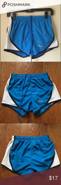 Fila Blue Athletic Shorts Bright blue Fila athletic shorts! In perfect condition and have only been worn once or twice. They have lining inside with a breathable fabric. Size small with included measurements for accuracy. Feel free to make an offer :) Fila Shorts