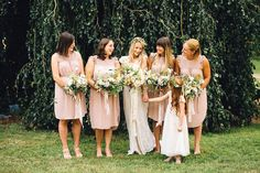 Bride Hannah wore a delicate lace gown by designer Jane Bourvis for her rustic and whimsical woodland wedding. Photography by Red on Blonde at Happy Valley Venue Norfolk