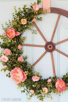 spring is in the air! it's time to change out your Christmas wreath into this farmhouse style wagon wheel wreath to welcome spring
