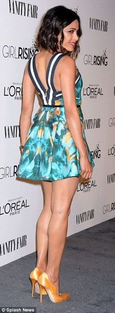 Freida Pinto flaunts her legs AND extreme cleavage in flirty mini-dress at pre-Oscar party in LA