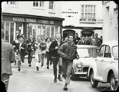 Skinheads running through the streets of Brighton chanting on support of their football team Chelsea. March 1970. By Bill Cross (Daily Mail / Rex Features) #skinhead #brighton #1970 #chelsea
