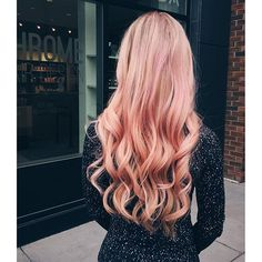 We're obsessed with this wavy strawberry pink Aveda hair color by David at Chrome Hair. Formula in comments.