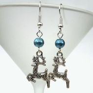 A cute pair of Christmas earrings, featuring tibetan silver reindeer charms. I have used a lovely shade of blue glass pearl bead in these earrings, but I can make in most colours on request. The earrings hang from silver plated earwires and have a drop...