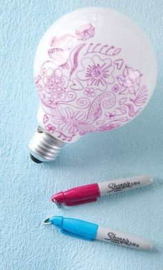 Did you know if you draw on a lightbulb you can have really cute designs shine on your wall at night? Cool idea!!!